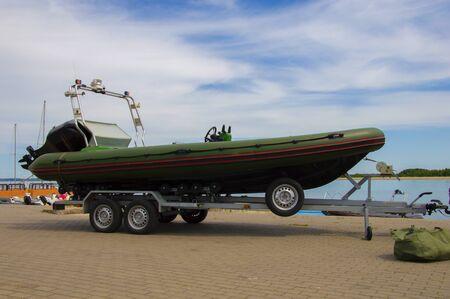 Photo pour Police boat. The concept of border protection, illegal trade, anti-terrorism, politics. Mixed media - image libre de droit