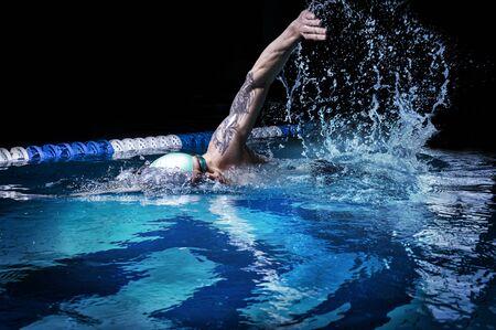 Photo pour Man crawls. Water sports concept. Mixed media - image libre de droit
