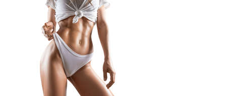 Foto für Image of a pumped up abs. Beautiful sportive woman posing in studio on a white background. Fitness, bodybuilding, aerobics concept. Mixed media - Lizenzfreies Bild