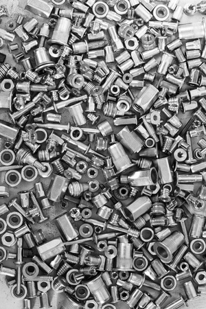 Photo pour Much of screws on the cement surface, black and white for textured background or wallpaper - image libre de droit