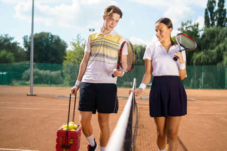 Young couple on tennis court