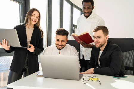 Photo for Group of business people working together on laptops on a new startup - Royalty Free Image