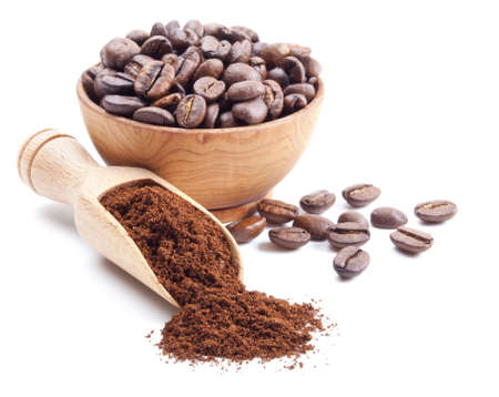 ground coffee and coffee beans isolated on white background