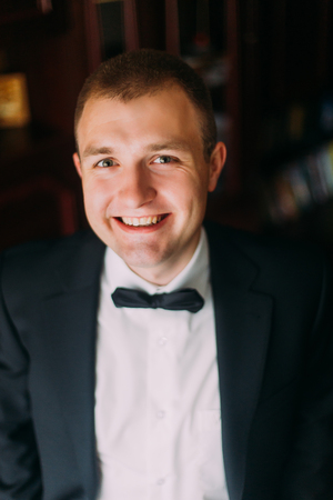 Confident and charisma. Close up portrait of happy young man with bowtie looking at camera.