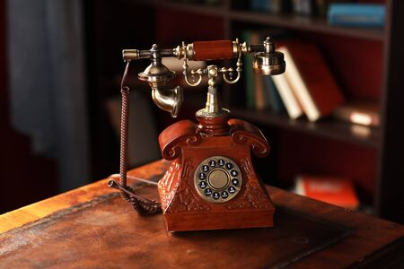 Photo for Old vintage retro telephone station. Great interior object. Old fashioned telephone. Vintage red phone - Royalty Free Image
