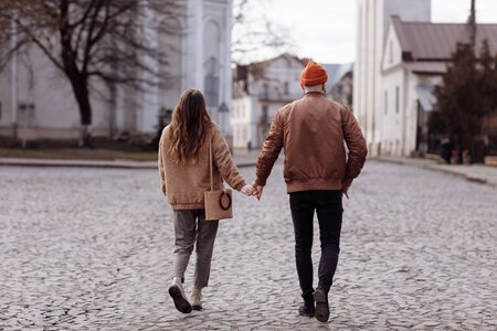 Photo for Love story of the beautiful young man and woman walking on the open air the city. embrace on a city walk. copy space. loving couple walking in the city in the open air. - Royalty Free Image