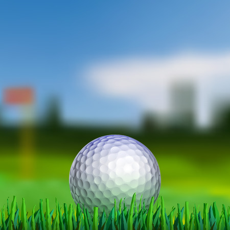 Golf ball on grass with blured fairway on background
