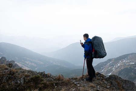 Photo pour Traveler blogger. Tours for photographers in the Alps - image libre de droit
