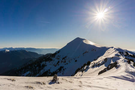 Picturesque view of the summit of Triantafilia snow covered mountain in Peloponnese Greece