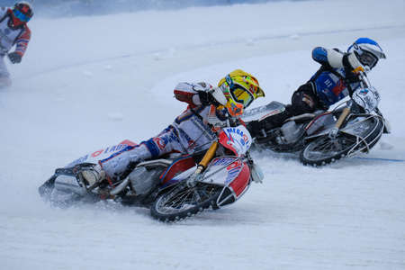 LUKHOVITSY,RUSSIA - FEBRUARY 17, 2016: Competition in ice Speedway , race riders