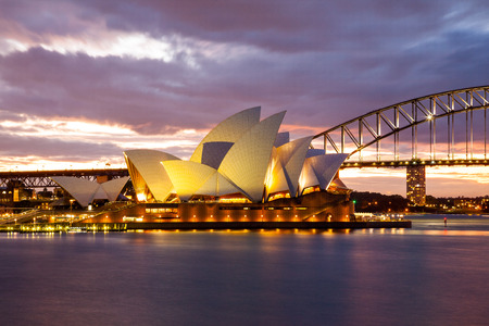 Sydney, Australia - July 11, 2010; Sydney Opera House and the Harbour Bridge at dusk  Taken from Mrs  Macquarie s Point