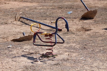 abandoned playground in sparse landscape