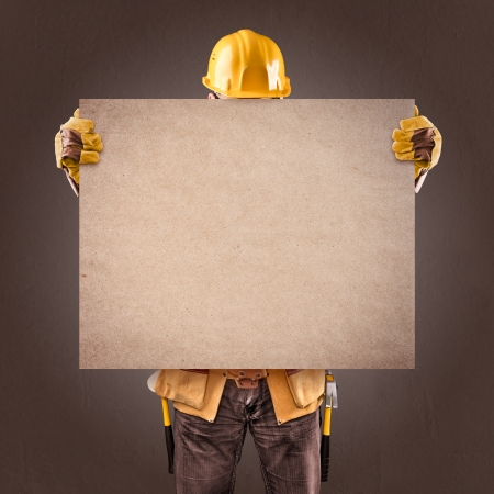 construction worker with information posters on a brown background