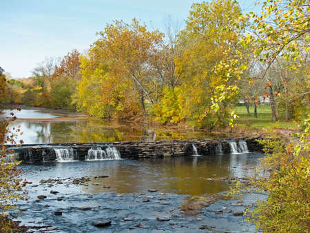 A beautiful stream waterfalls and Autumn leaves in Bucks County, Pennsylvania.