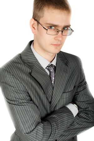 young businessman folding his arms isolated
