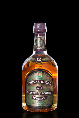 Valladolid, Spain, September 12th, 2011. Bottle of twelve years old scotch whiskey Chivas Regal om black backgroung, what  is a blended Scotch whisky produced by Chivas Brothers in Scotland. It is the market-leading Scotch whisky aged 12 years and above.