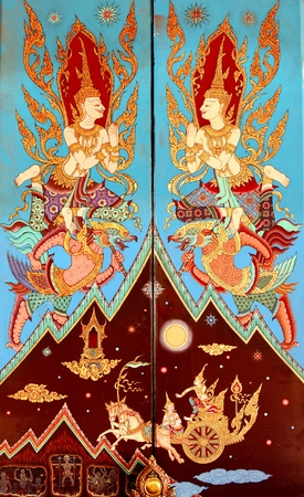 Ancien golden angel picture on the door in Thai temple. More than 200 year old picture in Wat Yai, Chonburi province in Thailand.