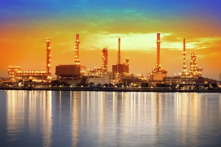 Landscape of river and oil refinery factory between sun rise time in Chao praya river, Bangkok, Thailand