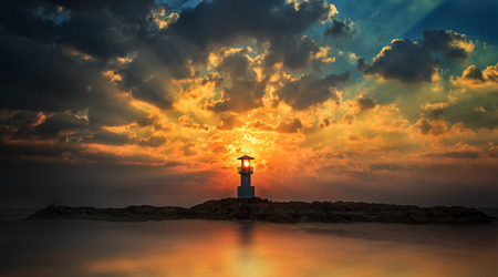 Lighthouse with light beam at sunset at Khao Lak