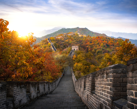 Foto de Chinese Great wall in Autumn and sunset, mountain and landmark very famous for travel near Beijing city, wall big one on the world, China, Asia - Imagen libre de derechos