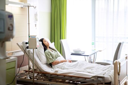 Photo pour Asian lady sleep and patient in hospital with iv solution, this immage can use for flu, sick, health, medical and medicine concept - image libre de droit