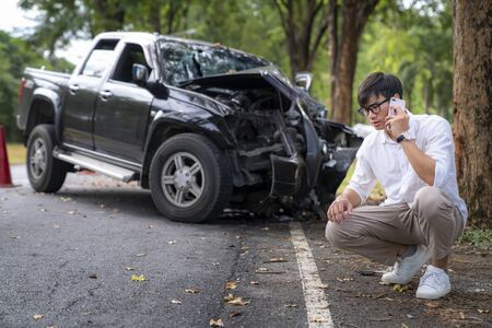 Man calling to insurance call center to help after a car crash accident on the road