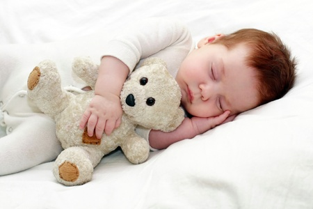 Photo for portrait of a close-up, infant lying on the bed - Royalty Free Image
