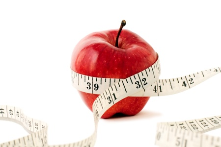 Photo for Photo of Fruit and Measuring Tape. - Royalty Free Image