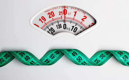 Photo pour Dieting weightloss slim down concept. Closeup measuring tape on white weight scale copy space text area - image libre de droit