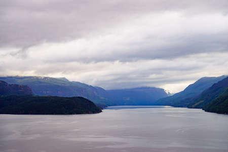 Foto für Norwegian landscape. Green mountains hills and fjord Saudafjord on overcast weather. National tourist Ryfylke route. - Lizenzfreies Bild