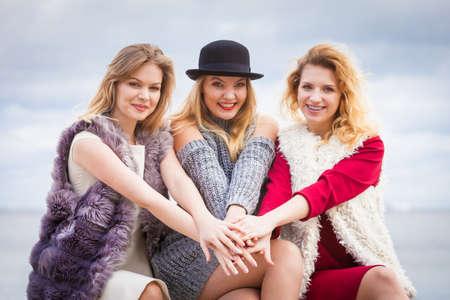 Photo pour Three fashionable women having presenting pretty stylish outfits. Style, fashion, friendship concept. - image libre de droit