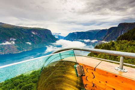 Photo pour Aurlandsfjord landscape from Stegastein viewing point, clouds over sea water surface. Norway Scandinavia. National tourist route Aurlandsfjellet. - image libre de droit