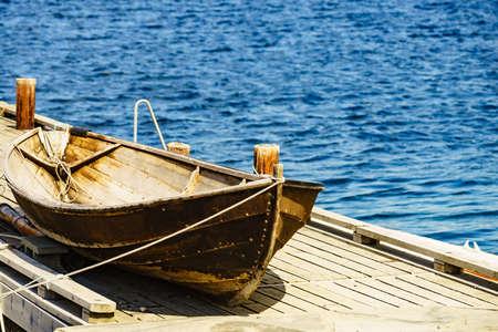Photo pour Old wooden boat on pier, fjord mountains landscape, Norway Europe - image libre de droit