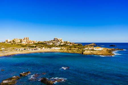Foto de Mediterranean Sea coast landscape, spanish coastline in Murcia region. Tourist site. Cala Reona in Cabo de Palos. - Imagen libre de derechos