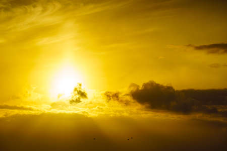 Foto de Sunrise over sea. Bright sun under the water surface. Sun up above horizon. Morning seascape. - Imagen libre de derechos