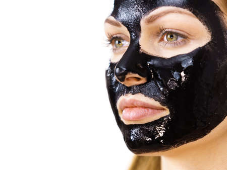 Photo pour Young woman with cosmetic on face, carbo detox black peel off mask. Spa treatment. Skincare. - image libre de droit