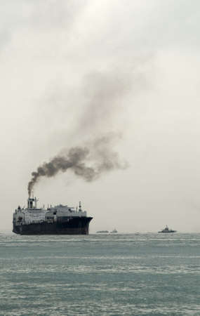Ship with thick black sooty exhaust