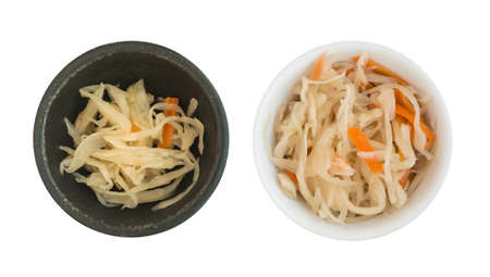Collection of Homemade Sauerkraut and Carrots in Black and White Round Bowls Isolated on White Background