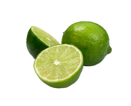 Foto de Sour key whole and sliced lime isolated on white background. Little juicy green lemon or fresh organic citrus - Imagen libre de derechos