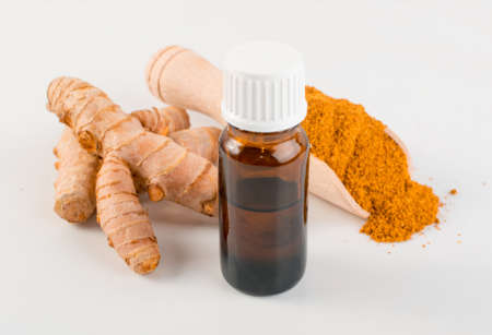 Photo pour Indian Spices Oil and Herbs Powders with Cumin, Curry, Curcuma Root, Turmeric and Chilli Pepper. Orange Seasoning Powder Mix Essence Isolated on White Background - image libre de droit