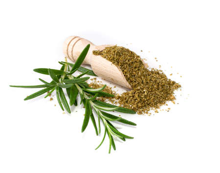 Photo for Pile of fish spices mix isolated. Blended seafood spice powders with seasoned salts, grounded saffron, anise, cumin, coriander, basil, fennel, fresh green rosemary, ginger - Royalty Free Image