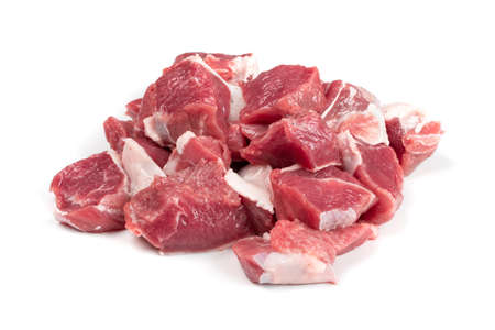 Photo pour Raw chopped lamb fillet, diced tenderloin or cubed mutton sirloin meat isolated. Fresh sheep fillet cubes, loin filet with ground pepper for skewers - image libre de droit