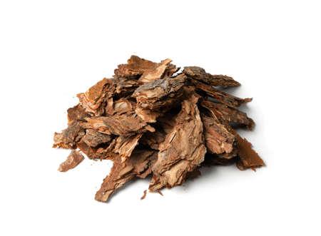 Foto de Heap of Dry Pine Tree Bark Pieces Isolated on White. Broken Woods Nature Chip - Imagen libre de derechos