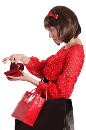 Woman with shopping bags and no money in purse over white