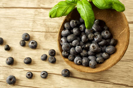 Super food - berries on wooden background