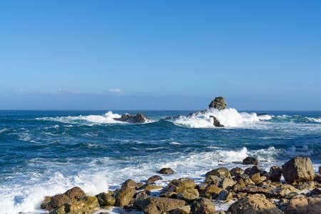 Photo pour The rough Atlantic Ocean near Tenerife, Spain, strong waves break on the rocks in the water - image libre de droit