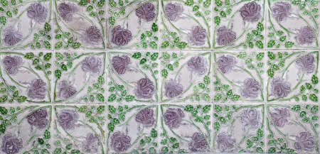 Photo pour A mosaic of Green and lilac floral pernanakan tiles, as typically found on the frontage of traditional Chinese shop houses. - image libre de droit