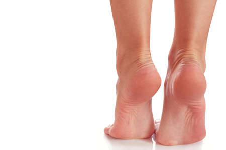 Photo pour female feet stand on their toes - image libre de droit