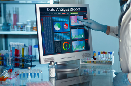 Foto de analyzing data scientist in the laboratory with a screen project development  researcher touching the screen of report research data - Imagen libre de derechos