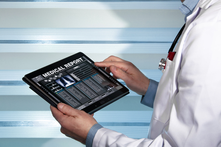 Photo pour practitioner with a medical record health on the screen a digital device / doctor with tablet data consulting a medical report of a patient - image libre de droit